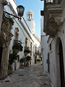 Locorotondo street in the city center and clock tower, Puglia, Italy
