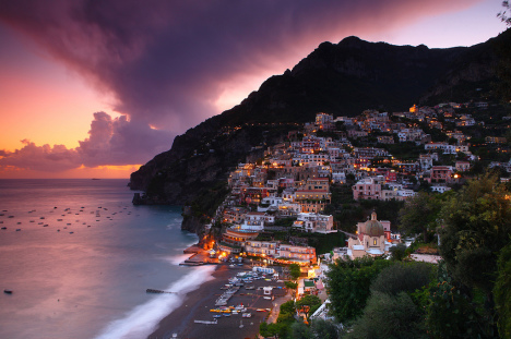 Positano at dusk with Spiaggia Grande, Campania, Italy
