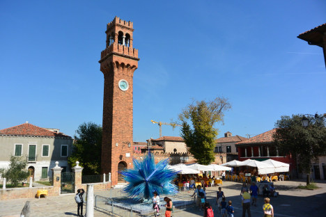 Murano with glass monument in the middle of Campo Santo Stefano, Veneto, Italy