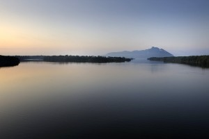The mountain of the Circeo as seen from the bridge that crosses Lake Paola (in Sabaudia), Lazio, Italy