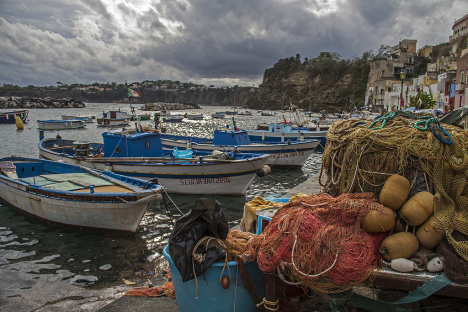 Fishing boats and nets in Procida island, Campania, Italy